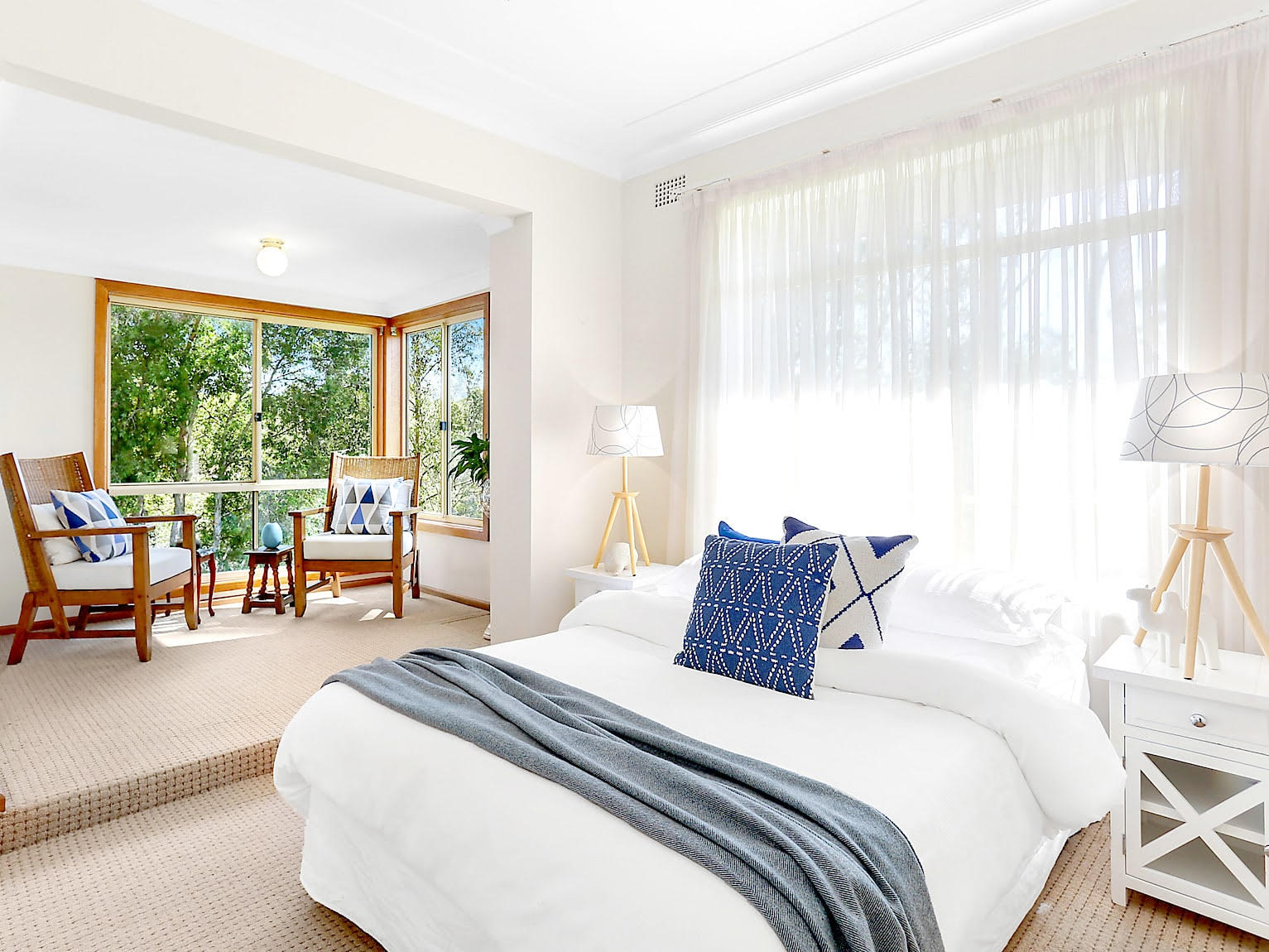 White bedroom and seating area