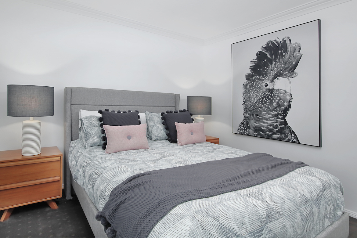 guest bedroom with grey tones and large cockatoo painting